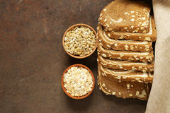 Whole grain bread with oat flakes. And seeds Royalty Free Stock Photos
