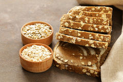 Whole grain bread with oat flakes. And seeds Stock Images