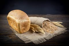 Whole grain bread. On old background stock images
