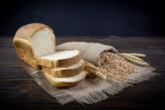 Whole grain bread. On old background Stock Photography