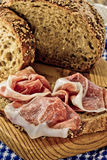 Whole grain bread and prosciutto ham Stock Photos