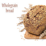 Whole grain bread with seeds on a wooden board, isolated Royalty Free Stock Images