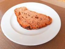 Whole grain bread slice on white dish Stock Photo