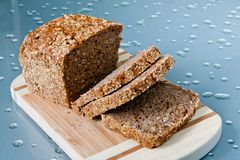 Whole grain bread. Sliced whole grain bread on the board Stock Image
