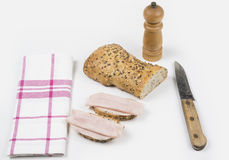 Whole grain bread. Two slices with ham and knife Stock Photography