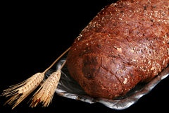 Whole grain bread with wheat spikes Stock Image