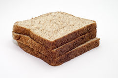 THE WHOLE GRAIN BREAD ON WHITE BACKGROUND. Royalty Free Stock Photography
