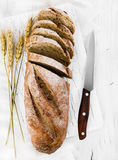 Whole grain bread on wooden background. Whole grain bread on white wooden background Stock Images