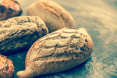Whole grain breads on the dark wooden background Stock Image