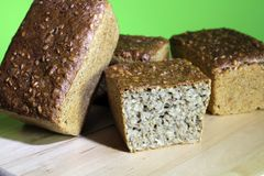 Whole grain breads on the tray, four dark breads. Loaves of black bread lie on the tray, cut into a loaf of black bread stock image