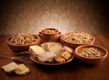 Whole grain carbohydrates. On wooden table stock photo