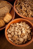 Whole grain carbohydrates. On wooden table royalty free stock image