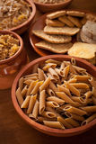 Whole grain carbohydrates. On wooden table royalty free stock photo