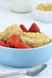 Whole grain cereal biscuits with strawberries Royalty Free Stock Image