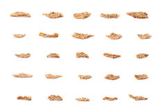 Whole grain cereal flake isolated. Set of multiple single whole grain cereal flakes isolated over the white background Royalty Free Stock Images