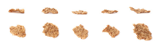 Whole grain cereal flake isolated. Single whole grain cereal flake set, isolated over the white background, each flake presented in two foreshortenings Stock Images
