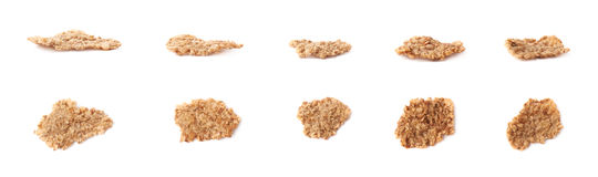 Whole grain cereal flake isolated. Single whole grain cereal flake set, isolated over the white background, each flake presented in two foreshortenings Royalty Free Stock Photography