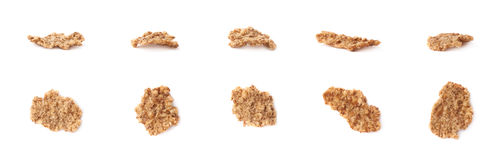 Whole grain cereal flake isolated. Single whole grain cereal flake set, isolated over the white background, each flake presented in two foreshortenings Stock Photos