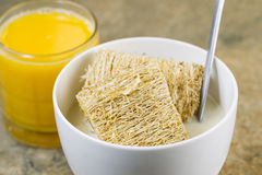 Whole grain cereal with honey and a glass of fresh orange juice Stock Photography