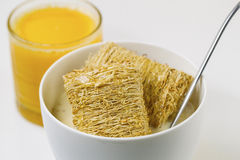 Whole grain Cereal, Honey and Orange Juice ready for breakfast Stock Photo
