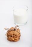 Whole grain cookies and fresh milk Stock Image