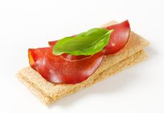 Whole grain crisp bread with smoked beef Royalty Free Stock Image