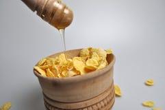 Whole-grain dry breakfast with honey, milk, fruit Stock Photos