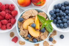 Whole-grain flakes with fresh fruit and berries on white table Stock Images