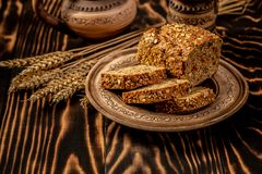 Whole grain goji berry bread put on kitchen wood old table. Fresh bread close-up. Slices of homemade bread on wooden background. The healthy eating and royalty free stock images