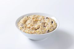 Whole grain oat porridge Stock Photos