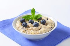 Whole grain oat porridge Stock Photo