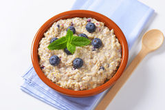 Whole grain oat porridge Stock Photography
