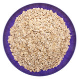 Whole Grain Oats in a Vibrant Purple Bowl Royalty Free Stock Image