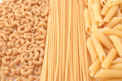 Whole grain pasta Stock Images