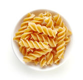 Whole grain pasta in bowl isolated on white, from above Royalty Free Stock Photo