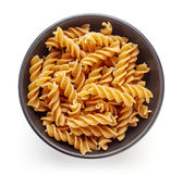 Whole grain pasta in bowl isolated on white, from above Stock Photo