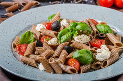 Whole grain pasta. With cheese, tomato and basil Royalty Free Stock Photo