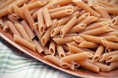Whole grain pasta. Close-up of dried whole grain pasta Royalty Free Stock Photography