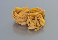 Whole grain pasta nests Royalty Free Stock Photo