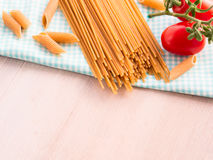 Whole grain pasta with raw fresh tomatoes Royalty Free Stock Photos
