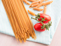 Whole grain pasta with tomatoes Royalty Free Stock Images