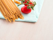 Whole grain pasta with tomatoes Stock Photo