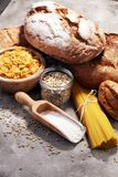 Whole grain products with complex carbohydrates. On rustic background stock image