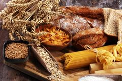Whole grain products with complex carbohydrates on table. Whole grain products with complex carbohydrates on rustic table royalty free stock image