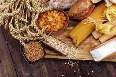 Whole grain products with complex carbohydrates on table. Whole grain products with complex carbohydrates on rustic table royalty free stock photo