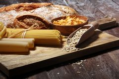 Whole grain products with complex carbohydrates on table. Whole grain products with complex carbohydrates on rustic table stock image