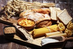 Whole grain products with complex carbohydrates on table. Whole grain products with complex carbohydrates on rustic table stock photos