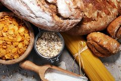 Whole grain products with complex carbohydrates. On rustic background royalty free stock photos