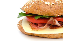 Whole grain roll with ham Royalty Free Stock Images