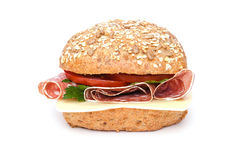 Whole grain roll with salami and cheese Royalty Free Stock Images